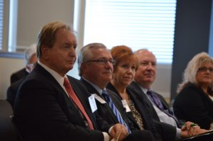 Cameron Smith (left), CEO of Cameron Smith & Associates; Wayne Callahan. senior adviser of Vestar Capital Partners; Bootsie Ackerman, district director for Congressman Womack; and Steve Schotta, executive director of Doing Business in Bentonville listen to Aliaksandr Zabella speak on behalf of the Belarus trade delegation.